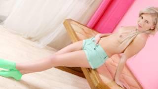 Blonde sluttish hot hooker in socks is topless posing sexually