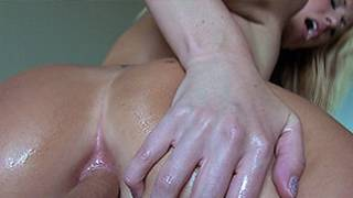 Oily ass of this adorable blonde is being jerked by a massive dick