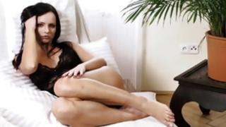 Dark-haired sexy babe looks gorgeous while self dildoing